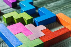 Colorful wooden blocks help complete a puzzle