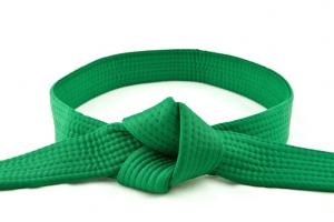 Green karate belt tied