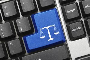 image of a scale of justice imprinted on a keyboard key