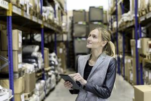 Picture of woman in warehouse with clipboard